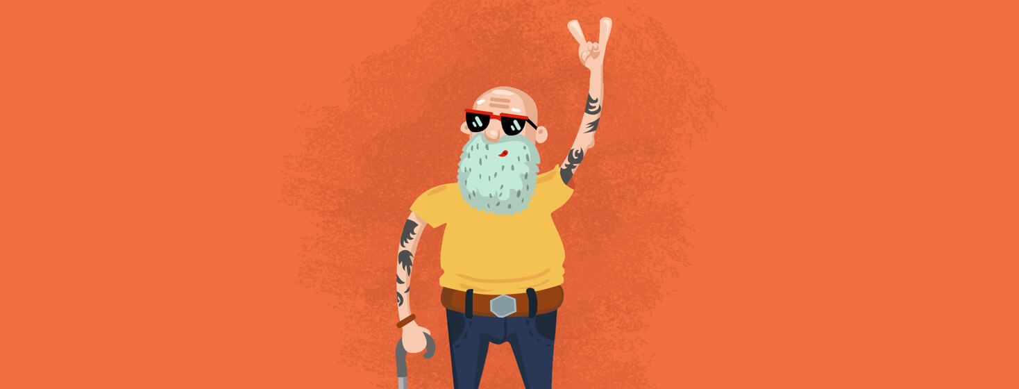 Older man with tattoos on his arms giving a peace sign