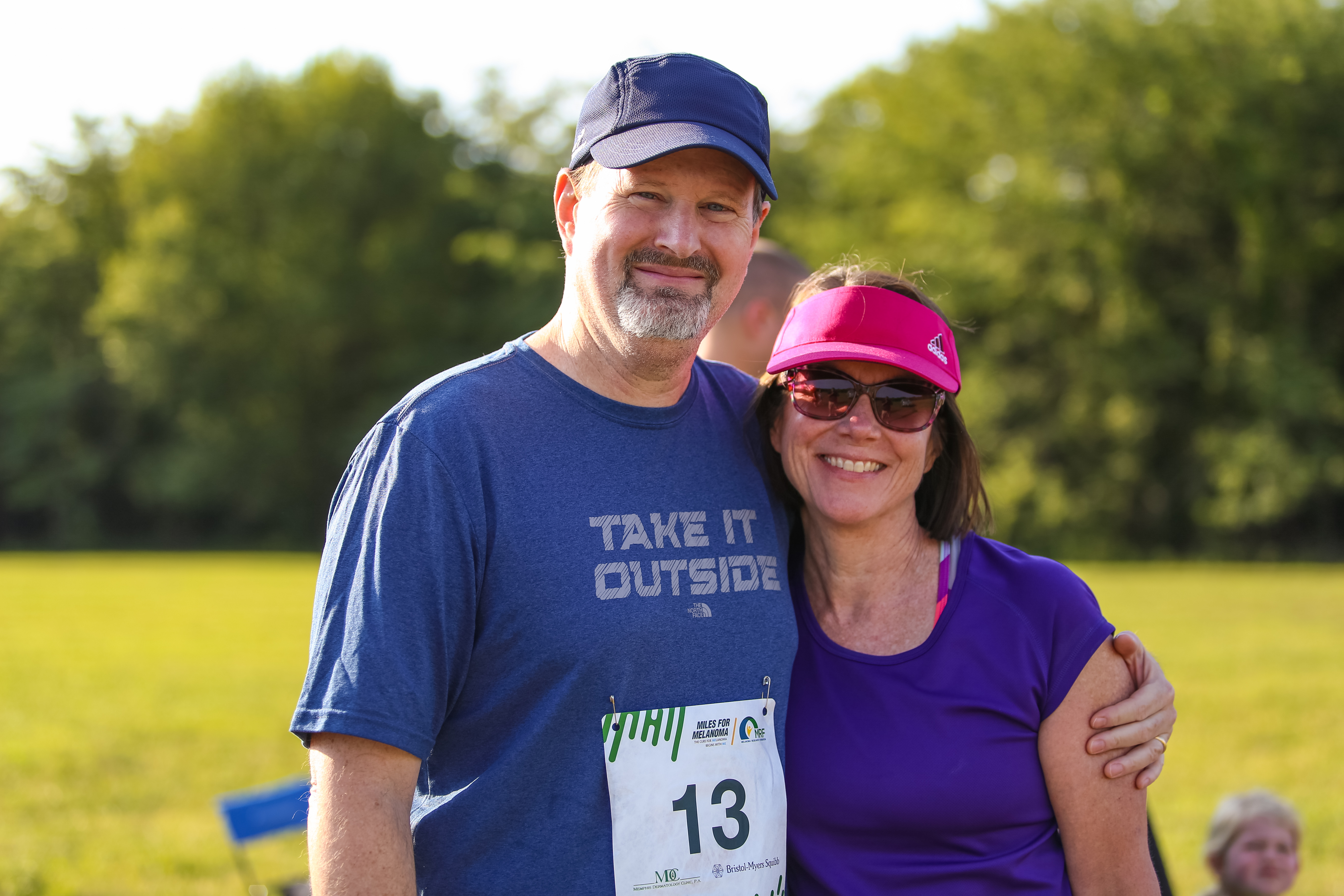 The author and his wife smiling in running clothes