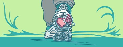 A pair of sneakers with a heart showing on the bottom
