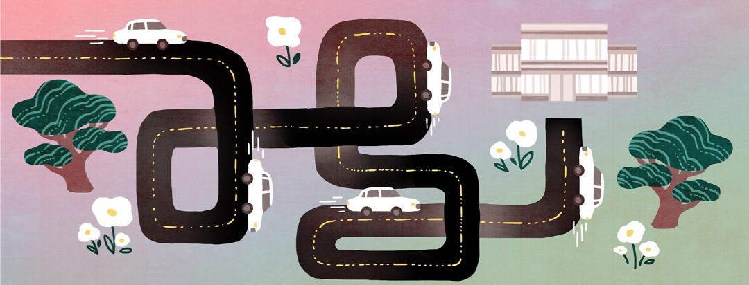 A car travels along a difficult and winding road on the way to the dermatologist's office.