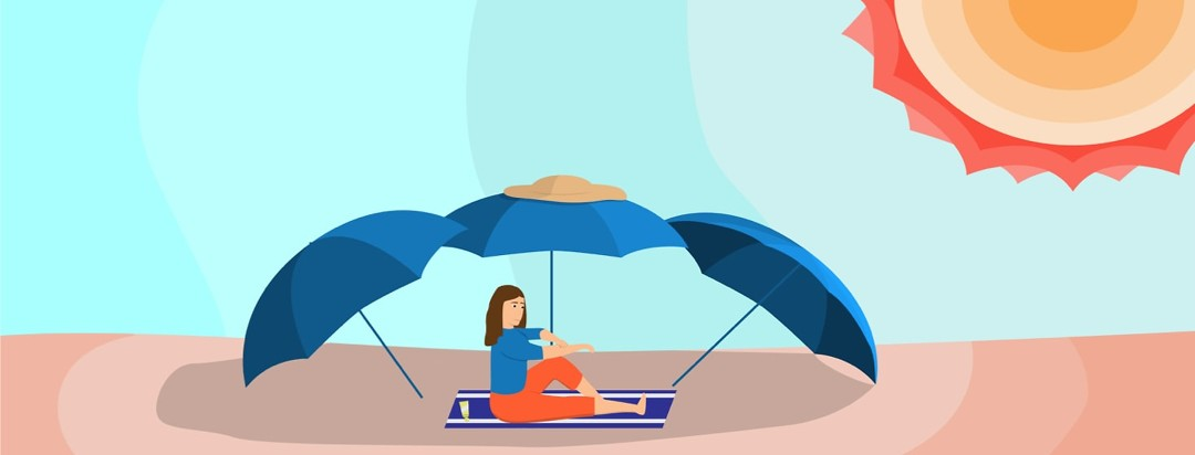 A woman sitting on a beach applying sunscreen under umbrellas fully protected from the sun.