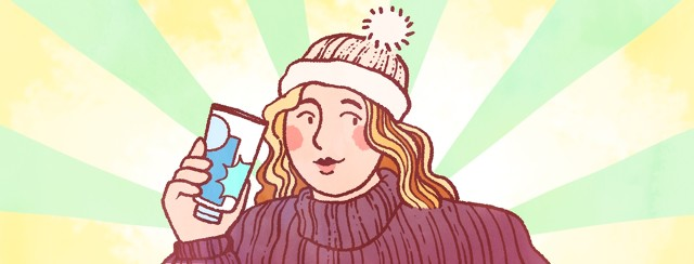 A woman wearing a knit hat and sweater proudly holds a bottle of sunscreen.