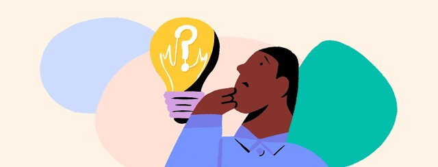 a man looking at a light bulb with a question mark in it