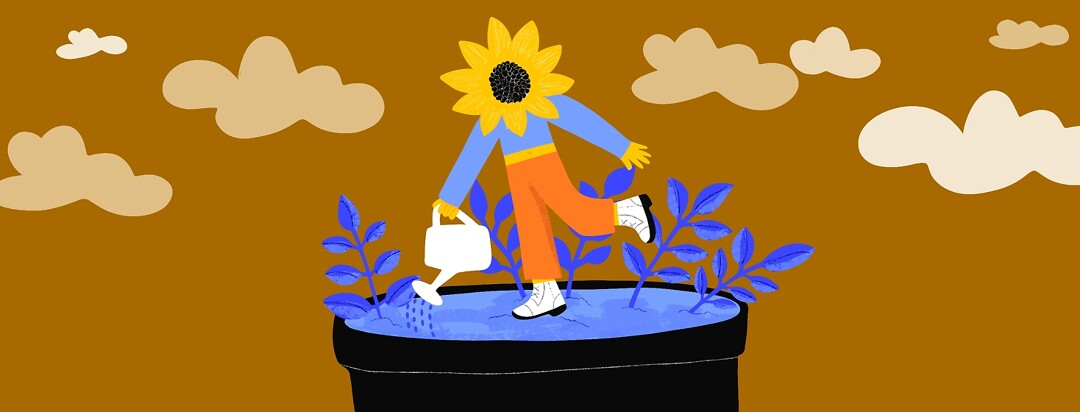 A person with a sunflower head stands in a pot and waters the soil that it's standing on from a watering can.