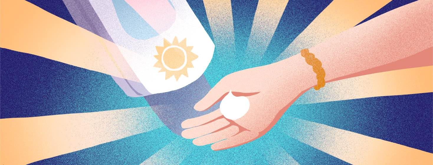 A hand reaches out to take sunscreen from a sunscreen dispenser.