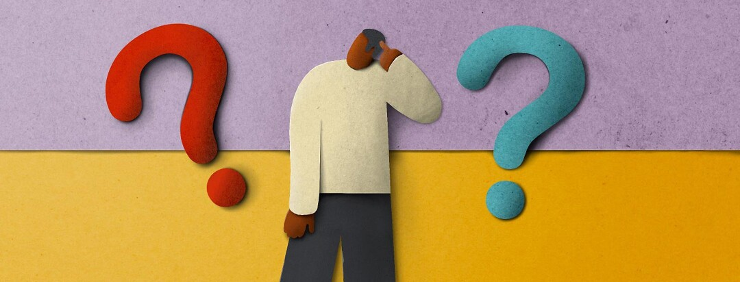 A paper cut-out man scratching his head between two question marks.